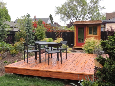 A finished wooden deck projects into the design